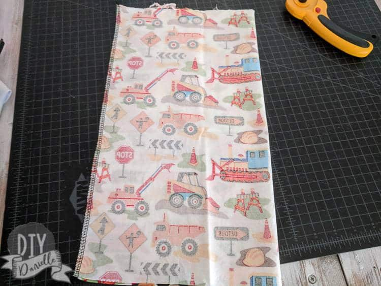 Sew the toy holder along the long edge, right sides together.