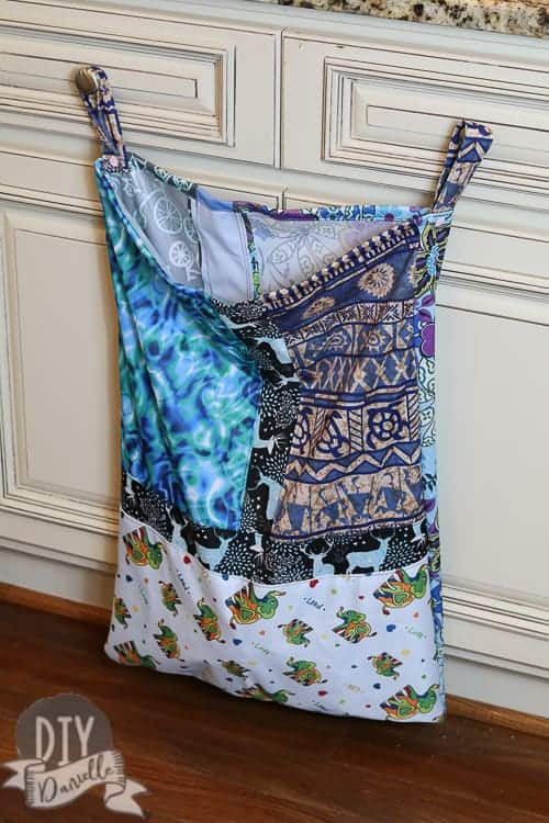 Strips of PUL scraps sewn together to create a large wet bag for the kitchen.