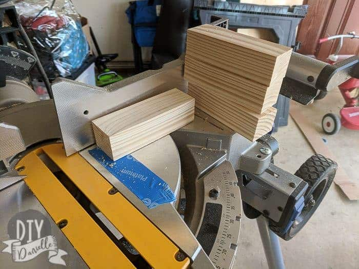 Cutting wood into legs for the cabinets.