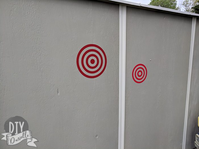 Nerf targets on the side of the shed.