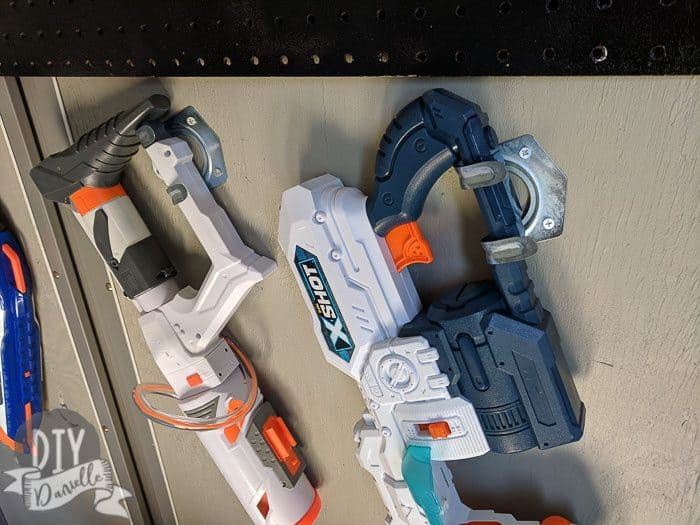 Nerf guns stored on $1 tool hooks. These are stored at an angle so they would fit.