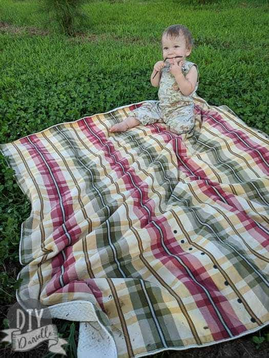 It's really easy to sew a custom picnic blanket for your family. This one has a carrying strap, snaps closed, and has toy tethers.