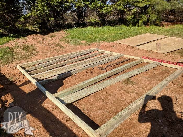 Wood being laid out for the shed base.