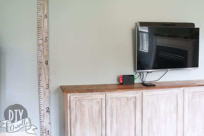 DIY Growth Chart next to matching cabinets.