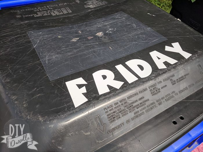 """Labeled recycling bin that says """"Friday"""" for the delivery day."""