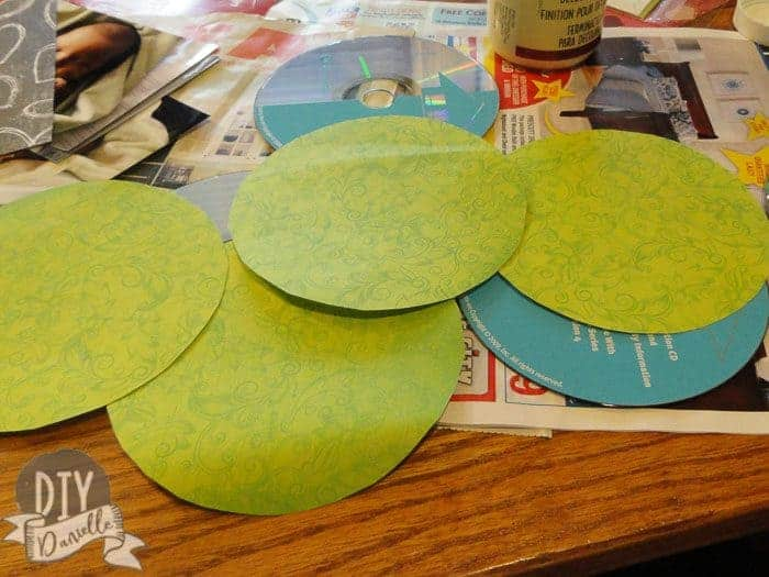 Cut out circles of scrap book paper for the CDS