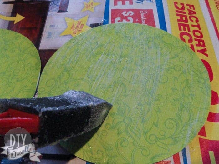 Using mod podge to stick scrapbook paper to CDs