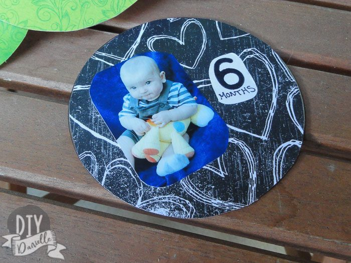 6 months old baby photo on scrapbook paper and a CD