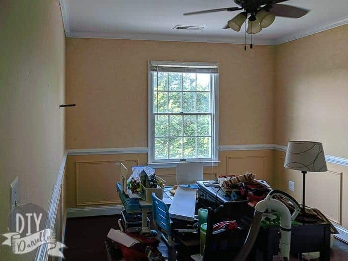 Before picture: Yellow walls with a white chair rail.