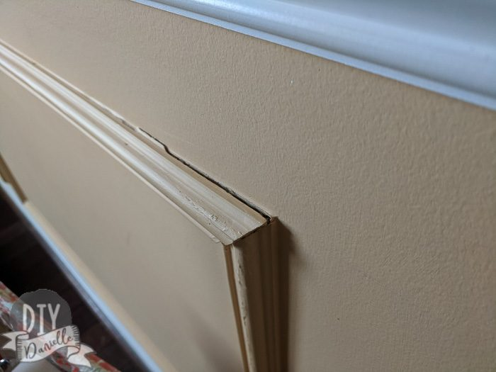 Wainscoting that was coming off the wall.