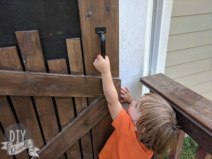 Door handle for screen door. My toddler opening it.