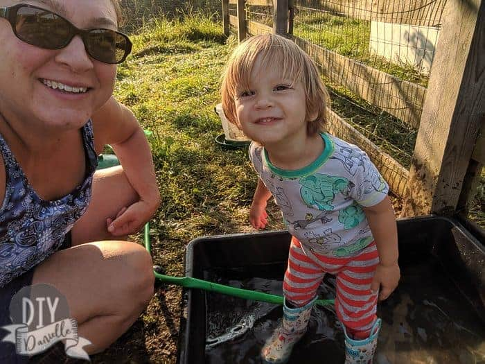 Me and my almost 2 year old who helps with farm chores every morning.