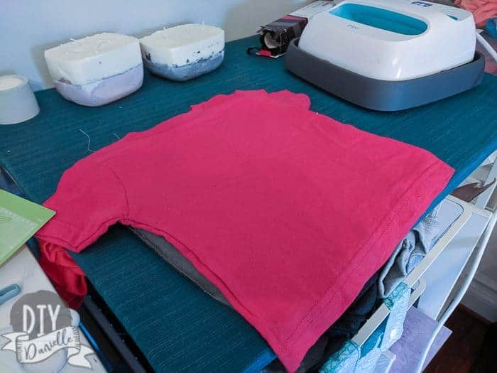 Red shirt ready to have the HTV applied.