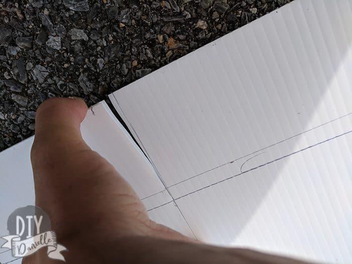 Cutting coroplast.