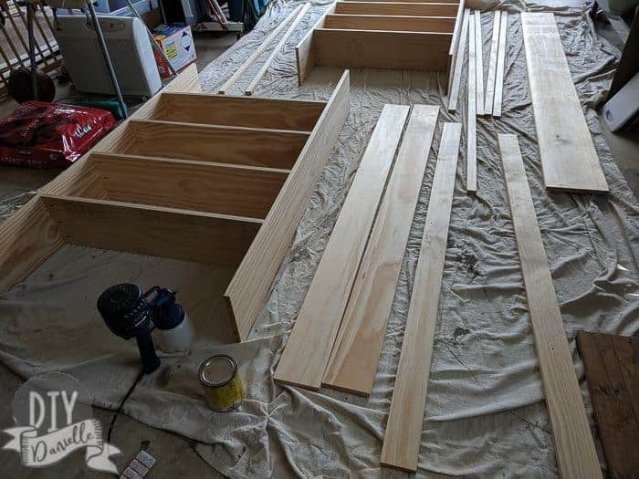 Laying out the wood to stain on top of a drop cloth.