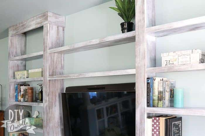 Final photo of the built-in bookshelves with trim added. Love the distressed finish.