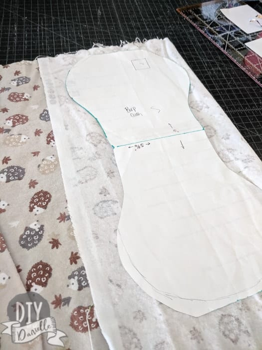 Cutting out my burp cloth pattern on flannel fabric.