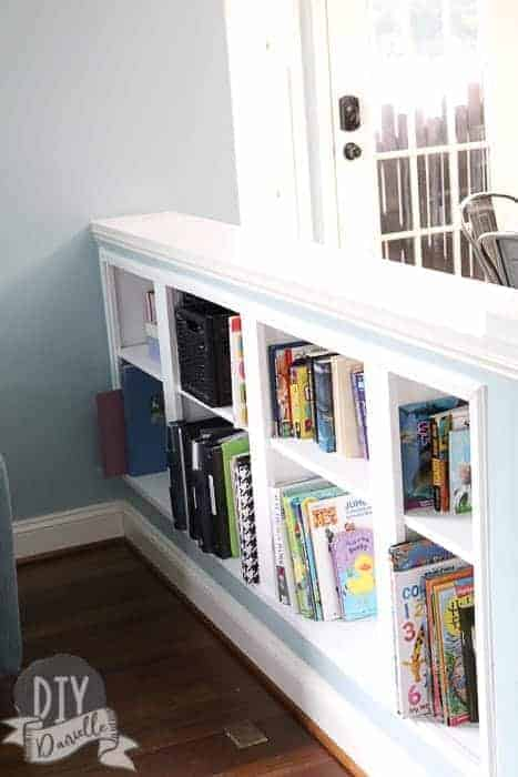 DIY Recessed Shelving tucked into a half wall between our kitchen and living room. This is a great way to create new space.