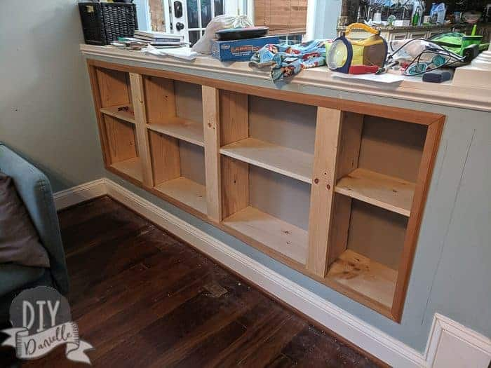 Trim added to frame the recessed shelving.