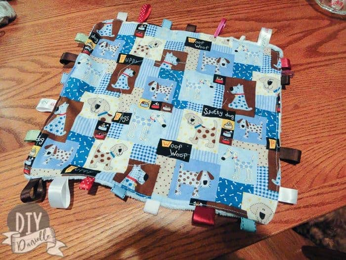 Quilting down the wipes container inside the tag blanket.