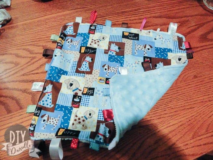 Tag blanket with minky backing.