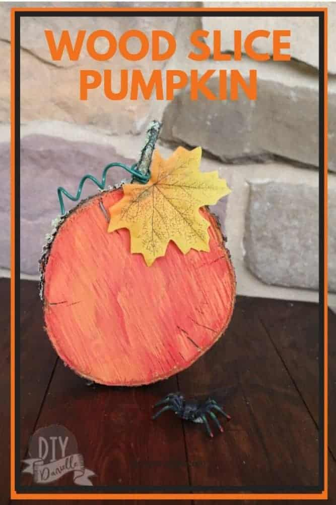 Easy pumpkin craft from a wood slice taken from our peach tree.