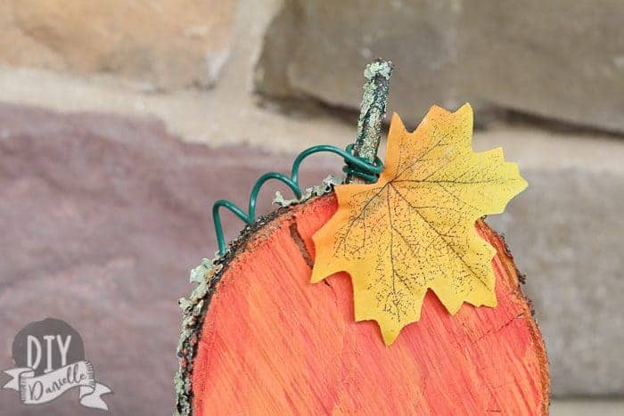 Close up of the wood slice turned into a Fall pumpkin!