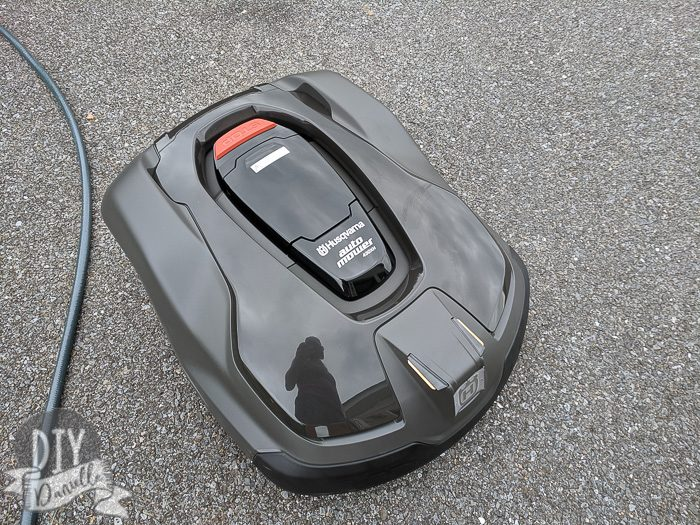 Photo of the Husqvarna Automower in off position on driveway before install.