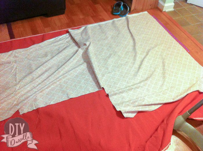 Sewing fabric together to make an L shaped cover for the couch.