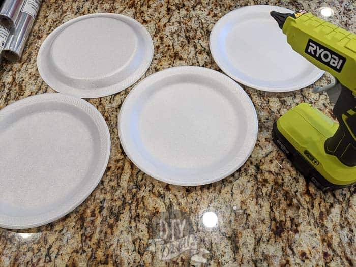Foam plates and glue gun.
