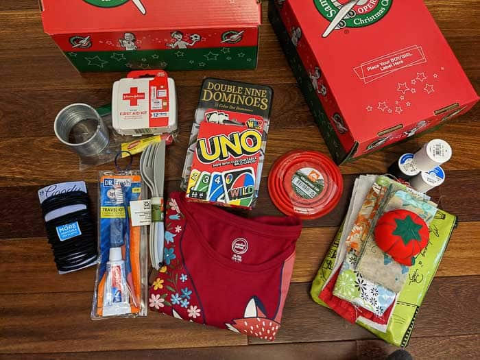 Along with a sewing kit, I was able to fit Dominoes, hair ties, a shirt, a slinky, UNO cards, and other items in a box for a 10-14 year old girl.