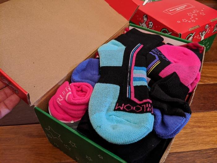 Socks in top of shoe box.