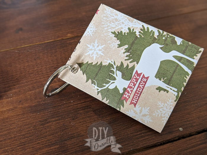 Folding gift tags with a binder ring through them.