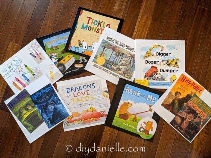 Book Jacket Wall Art Craft: Using all of our favorite children's books to make decor for the playroom wall.