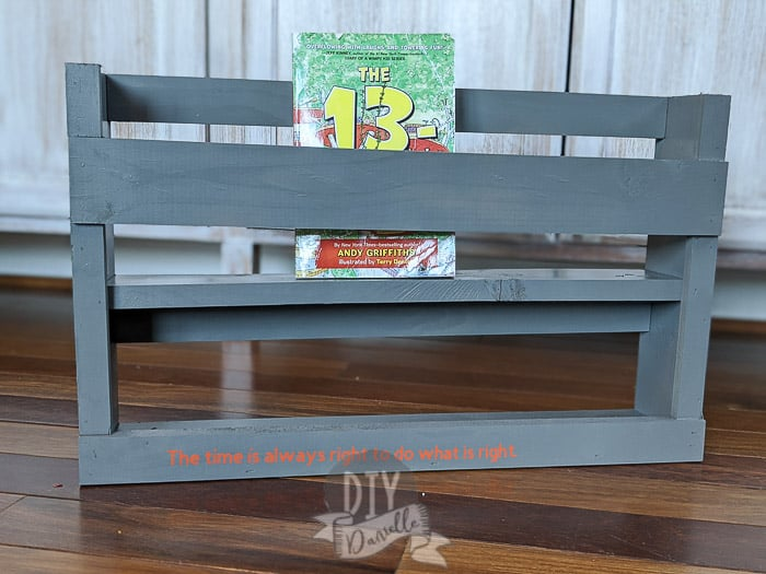 Bunk Shelf with a book in it.