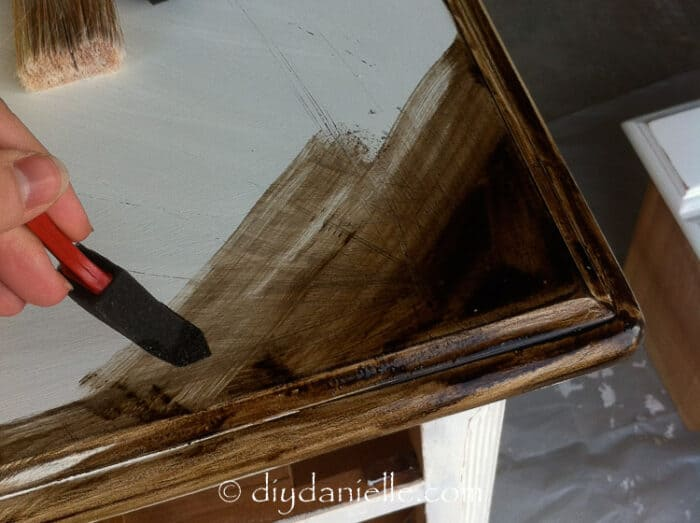 Applying the stain to the top of the bureau.