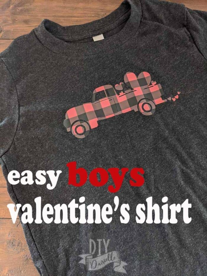 Easy boys Valentine's Day shirt with a truck in buffalo plaid with hearts on it. Placed on a black shirt.