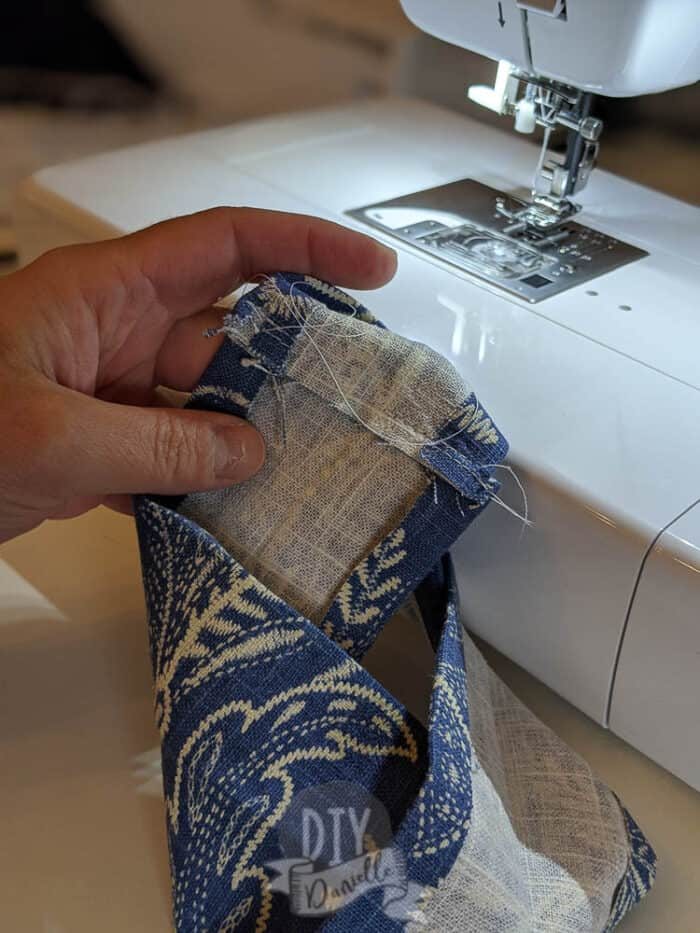 """Sewing short ends of the 20"""" strip right sides together."""