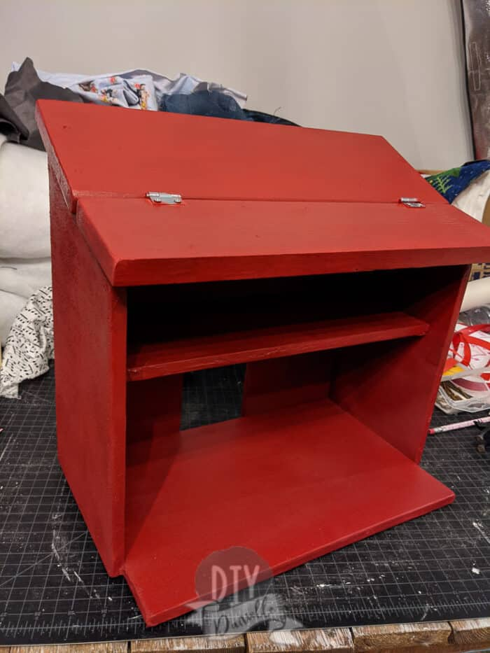Wood toy barn spray painted red.