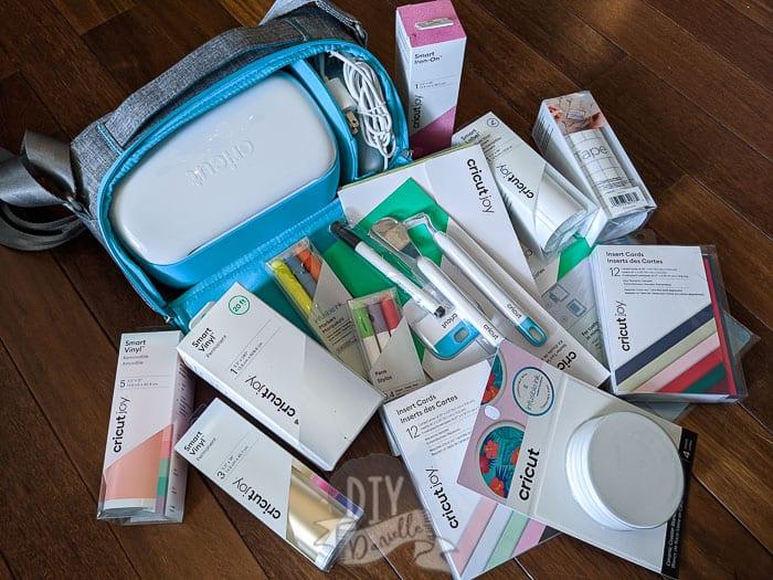 Supplies for Cricut Joy! Lots of Cricut Joy Smart Vinyl, pens, and other tools. Cricut Joy + special carrying case.