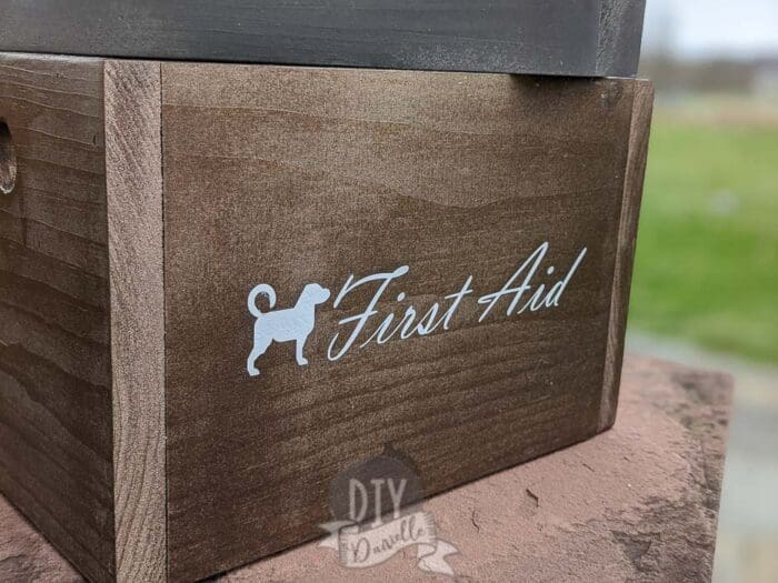 """""""First Aid"""" supply box for my dog that was labeled using white Cricut Iron On Vinyl."""