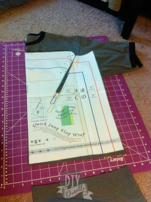 Cutting out the pattern for a quick snap flap wrap on top of a men's shirt.