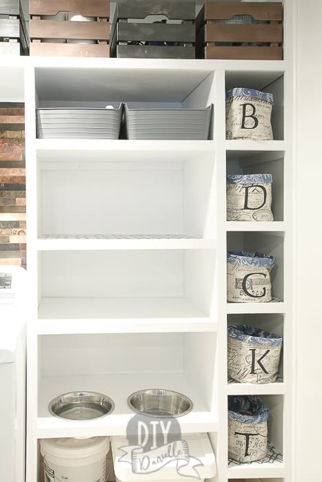 Left: DIY pantry shelf. This gives us a place to store small appliances and a spot to feed the dog below. Right: This is a row of small baskets for socks. Each person's basket is marked with the first letter of their name. Shoes are hidden behind the basket.
