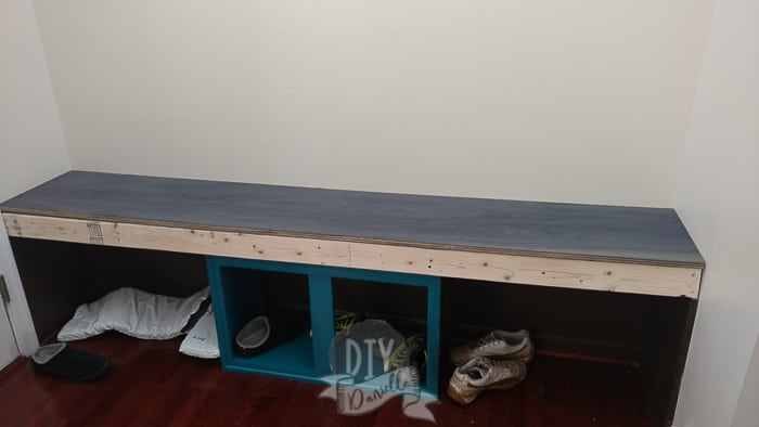 Plywood on top of the frame for the bench.