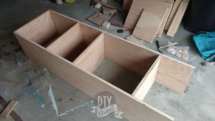 Shelves being built for either side of the seating bench.