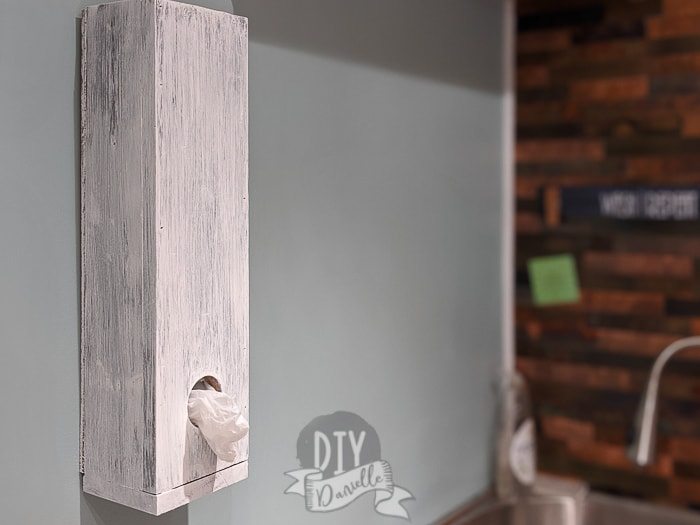 Wood grocery bag dispenser hanging on the wall in my mudroom!