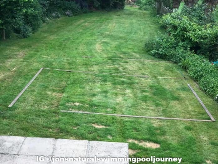 The lawn before the swimming pond was adding. Wood laid out for the shape of the pool.