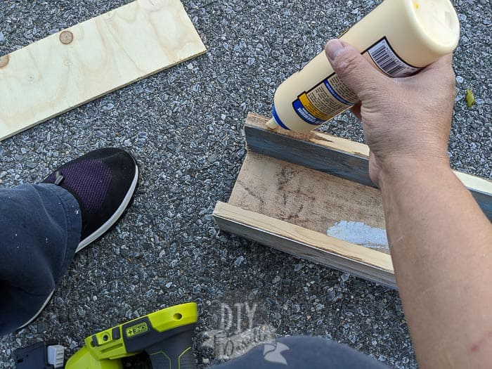 Gluing on the piece for the back of the dispenser.