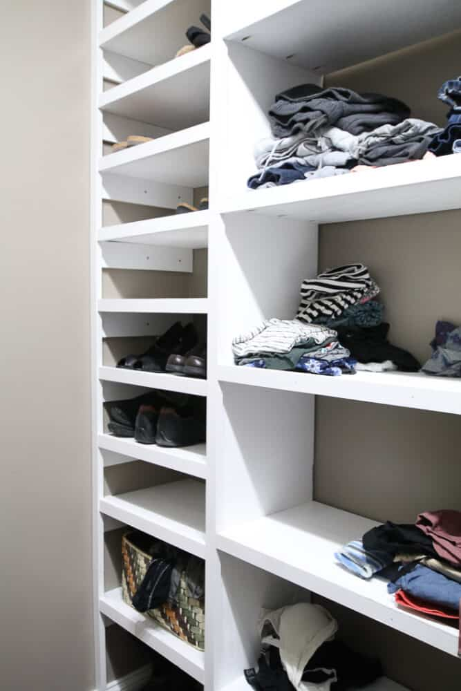 Shoe shelf using side supports along an interior wall. I needed to use a lot of wall anchors here and it was very time consuming. (White shelves with shoes on them)