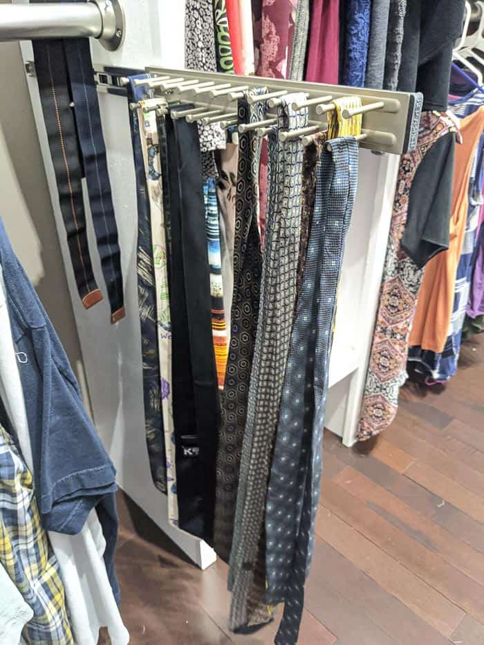 Silver/Chrome Tie rack that slides out from closet. It needs to be screwed into wood shelving or the wall.